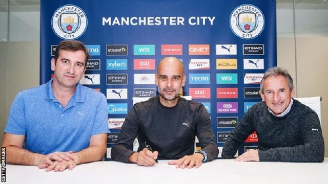 Pep Guardiola: Manchester City boss signs new two-year deal